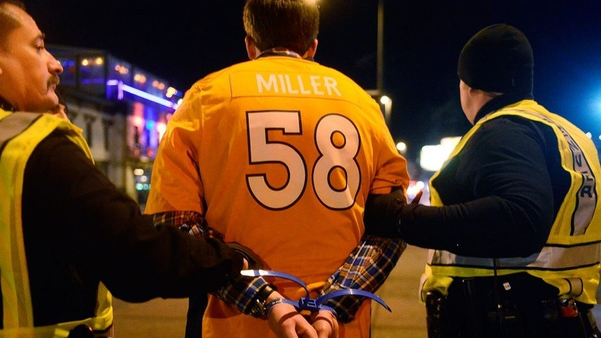<p>DENVER, CO - FEBRUARY 7: A fan gets arrested after being taken from the Lodo's Bar and Grill at the intersection of 20th St. and Market St. on February 7, 2016 in Denver, Colorado. Fans celebrated in the street of Denver after the Denver Broncos defeated the Carolina Panthers 24-10 to win Super Bowl 50. (Photo by Brent Lewis/The Denver Post via Getty Images)</p>