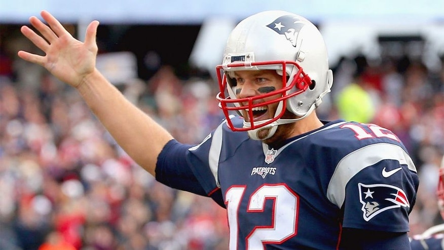 FOXBORO, MA - OCTOBER 25: Tom Brady #12 of the New England Patriots reacts after throwing a touchdown pass during the fourth quarter against the New York Jets at Gillette Stadium on October 25, 2015 in Foxboro, Massachusetts. (Photo by Jim Rogash/Getty Images)