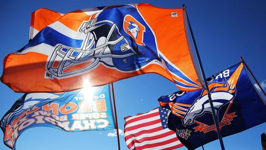 DENVER, CO - JANUARY 12: Denver Broncos flags are displayed prior to the AFC Divisional Playoff Game between the Denver Broncos and the San Diego Chargers at Sports Authority Field at Mile High on January 12, 2014 in Denver, Colorado. (Photo by Justin Edmonds/Getty Images)