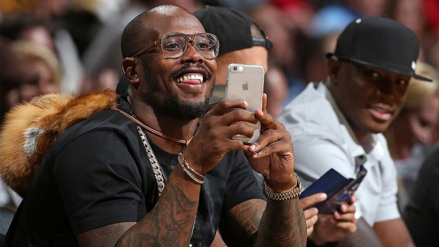 DENVER, CO - NOVEMBER 13: Von Miller of the Denver Broncos uses his iPhone as he watches from courtside as the Houston Rockets face the Denver Nuggets at Pepsi Center on November 13, 2015 in Denver, Colorado. The Nuggets defeated the Rockets 107-98. NOTE TO USER: User expressly acknowledges and agrees that, by downloading and or using this photograph, User is consenting to the terms and conditions of the Getty Images License Agreement. (Photo by Doug Pensinger/Getty Images)