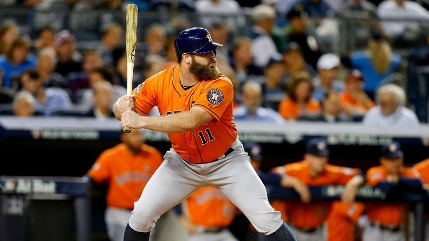 NEW YORK, NY - OCTOBER 06: (NEW YORK DAILIES OUT) Evan Gattis #11 of the Houston Astros in action against the New York Yankees during the American League Wild Card Game at Yankee Stadium on October 6, 2015 in the Bronx borough of New York City, New York. The Astros defeated the Yankees 3-0. (Photo by Jim McIsaac/Getty Images)