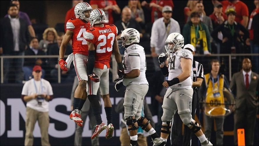 <p>Jan 12, 2015; Arlington, TX, USA; Ohio State Buckeyes safety Tyvis Powell (23) and linebacker Darron Lee (43) celebrates a sack against the Oregon Ducks in the 2015 CFP National Championship Game at AT&T Stadium. <br> </p>
