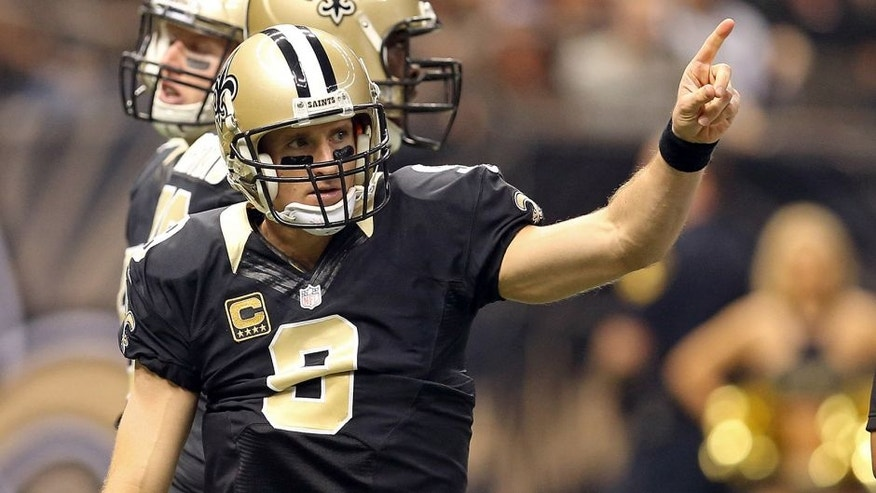 Dec 27, 2015; New Orleans, LA, USA; New Orleans Saints quarterback Drew Brees (9) gestures during the first quarter of their game against the Jacksonville Jaguars at the Mercedes-Benz Superdome. Mandatory Credit: Chuck Cook-USA TODAY Sports