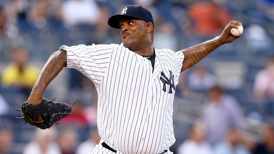 NEW YORK, NY - AUGUST 18: CC Sabathia #52 of the New York Yankees delivers a pitch in the first inning against the Minnesota Twins on August 18, 2015 at Yankee Stadium in the Bronx borough of New York City. (Photo by Elsa/Getty Images)