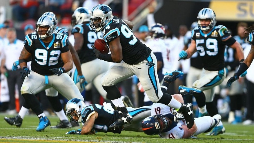 Feb 7, 2016; Santa Clara, CA, USA; Carolina Panthers defensive end Kony Ealy (94) returns an interception against the Denver Broncos in the second quarter in Super Bowl 50 at Levi's Stadium. Mandatory Credit: Mark J. Rebilas-USA TODAY Sports