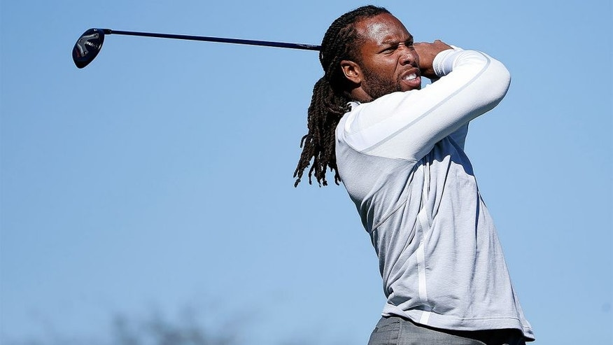 SCOTTSDALE, AZ - FEBRUARY 03: Arizona Cardinals wide receiver Larry Fitzgerald hits a tee shot on the 15th hole during the pro-am for the the Waste Management Phoenix Open at TPC Scottsdale on February 3, 2016 in Scottsdale, Arizona. (Photo by Christian Petersen/Getty Images)