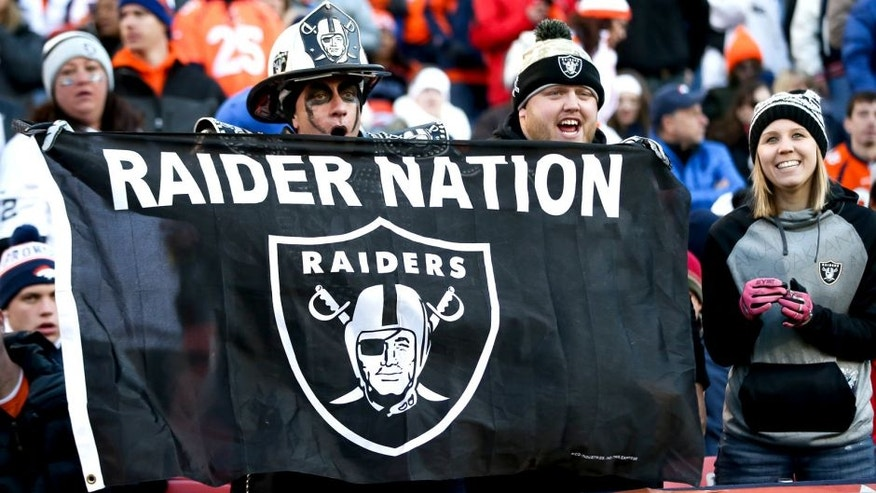 DENVER, CO - DECEMBER 13: Oakland Raiders fans cheer as their team leads the Denver Broncos at Sports Authority Field at Mile High on December 13, 2015 in Denver, Colorado. (Photo by Doug Pensinger/Getty Images)
