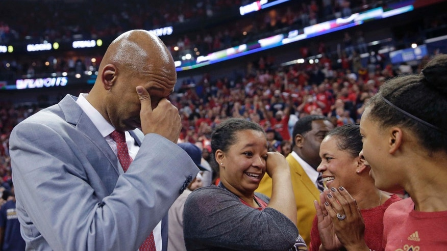 FILE - In this April 15, 2015, file photo, New Orleans Pelicans coach Monty Williams reacts after the team's victory in an NBA basketball game against the San Antonio Spurs in New Orleans. Williams' wife, Ingrid Williams, is second from right.