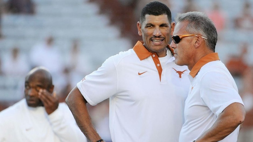 Sep 12, 2015; Austin, TX, USA; Texas Longhorns wide receivers coach Jay Norvell (left) talks with quarterbacks coach Shawn Watson (right) prior to kick off against the Rice Owls at Darrell K Royal-Texas Memorial Stadium. Texas beat Rice 42-28. Mandatory Credit: Brendan Maloney-USA TODAY Sports
