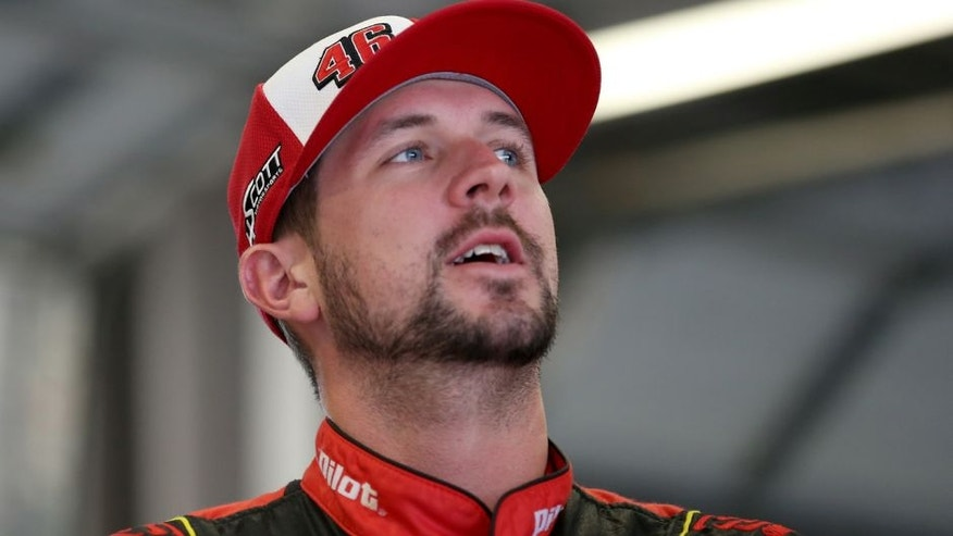 SPARTA, KY - JULY 10: Michael Annett, driver of the #46 Pilot/Flying J Chevrolet, looks on from the garage area during a rain delay in practice for the NASCAR Sprint Cup Series Quaker State 400 Presented by Advance Auto Parts at Kentucky Speedway on July 10, 2015 in Sparta, Kentucky. (Photo by Todd Warshaw/Getty Images)