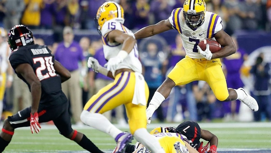 Dec 29, 2015; Houston, TX, USA; LSU Tigers running back Leonard Fournette (7) rushes against the Texas Tech Red Raiders in the first quarter at NRG Stadium. Mandatory Credit: Thomas B. Shea-USA TODAY Sports