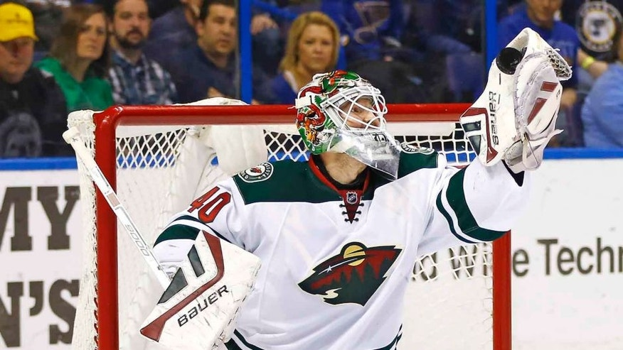 <p>Saturday, March 14: Minnesota Wild goalie Devan Dubnyk makes a glove save during the first period against the St. Louis Blues. Dubnyk made 41 saves in the 3-1 win.</p>