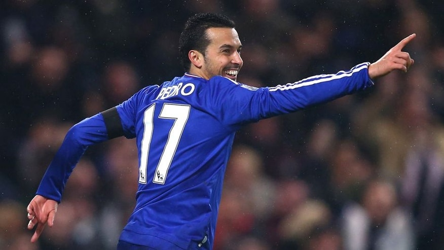LONDON, ENGLAND - FEBRUARY 13: Pedro of Chelsea celebrates scoring his team's fourth goal during the Barclays Premier League match between Chelsea and Newcastle United at Stamford Bridge on February 13, 2016 in London, England. (Photo by Clive Rose/Getty Images)