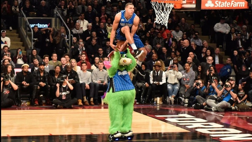 Orlando Magic forward Aaron Gordon competes during the NBA all-star slam dunk skills competition in Toronto on Saturday, Feb. 13, 2016. (Mark Blinch/The Canadian Press via AP) MANDATORY CREDIT