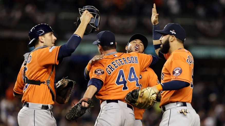 Oct 6, 2015; Bronx, NY, USA; Houston Astros relief pitcher Luke Gregerson (44) celebrates with teammates after defeating the New York Yankees in the American League Wild Card playoff baseball game at Yankee Stadium. Houston won 3-0. Mandatory Credit: Adam Hunger-USA TODAY Sports