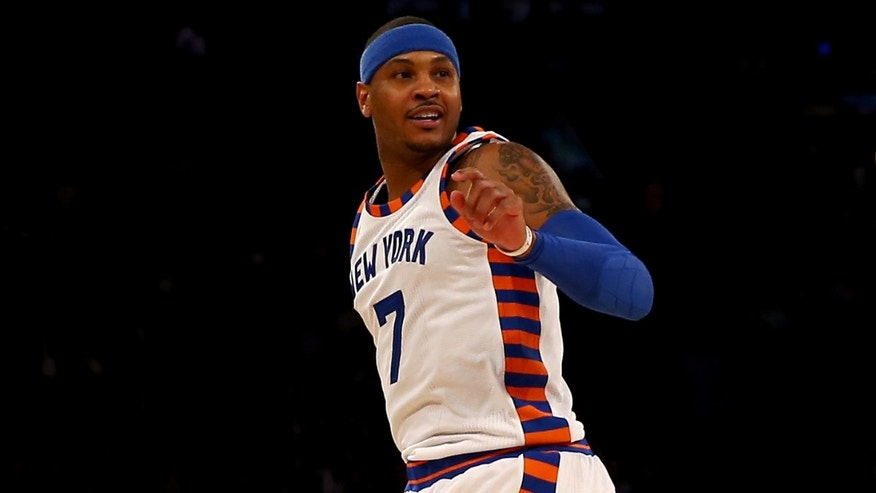 NEW YORK, NY - JANUARY 12:  Carmelo Anthony #7 of the New York Knicks reacts after a missed shot in the first half against the Boston Celtics at Madison Square Garden on January 12, 2016 in New York City. NOTE TO USER: User expressly acknowledges and agrees that, by downloading and or using this photograph, User is consenting to the terms and conditions of the Getty Images License Agreement.  (Photo by Elsa/Getty Images)