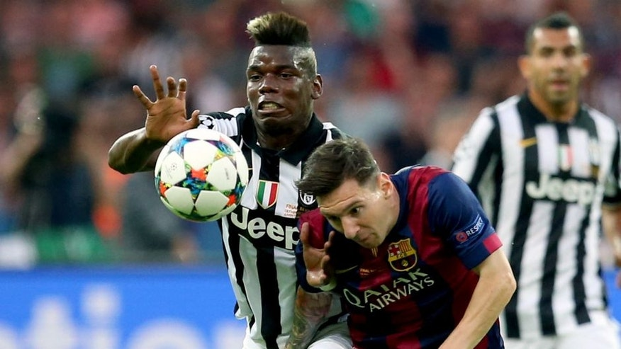 BERLIN, GERMANY - JUNE 06 : Lionel Messi of Barcelona (R) vies with Paul Pogba (L) of Juventus during the UEFA Champions League Final between Juventus and FC Barcelona at Olympiastadion on June 6, 2015 in Berlin, Germany. (Photo by Fishing4/Anadolu Agency/Getty Images)
