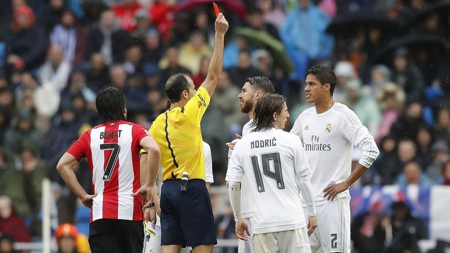 MADRID, SPAIN - FEBRUARY 13: Referee Alfonso Alvarez shows a red card to Raphael Varane of Real Madrid during the La Liga match between Real Madrid CF and Athletic Club at Estadio Santiago Bernabeu on February 13, 2016 in Madrid, Spain. (Photo by Angel Martinez/Real Madrid via Getty Images)