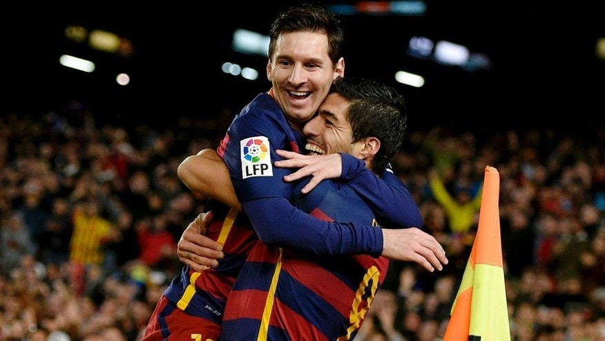 Barcelona's Uruguayan forward Luis Suarez (R) celebrates a goal with Barcelona's Argentinian forward Lionel Messi (C) and Barcelona's Brazilian defender Dani Alves during the Spanish league football match FC Barcelona vs RC Celta de Vigo at the Camp Nou stadium in Barcelona on February 14, 2016. / AFP / LLUIS GENE (Photo credit should read LLUIS GENE/AFP/Getty Images)