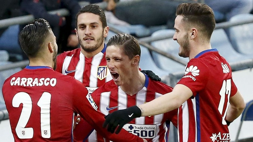 Football Soccer - Getafe v Atletico Madrid - Spanish Liga BBVA - Coliseum Alfonso Perez stadium, Madrid, Spain - 14/02/16 Atletico Madrid players celebrate Fernando Torres' goal. REUTERS/Andrea Comas Picture Supplied by Action Images