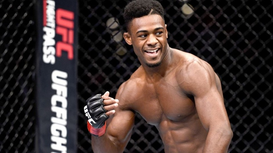 LAS VEGAS, NEVADA - DECEMBER 10: Aljamain Sterling celebrates his win over Johnny Eduardo in their bantamweight bout during the UFC Fight Night event at The Chelsea at the Cosmopolitan of Las Vegas on December 10, 2015 in Las Vegas, Nevada. (Photo by Jeff Bottari/Zuffa LLC/Zuffa LLC via Getty Images)