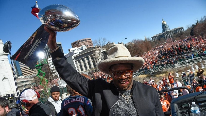 DENVER, CO - FEBRUARY 09: Denver Broncos Von Miller smiles as he holds up the Super Bowl trophy on the stage during the celebration. Von Miller was named MVP of Super Bowl 50 after their 24-10 victory over the Carolina Panthers. The Denver Broncos celebrated their Super Bowl victory with a a parade and celebration February 9, 2016 at the City & County Building. (Photo By John Leyba/The Denver Post via Getty Images)