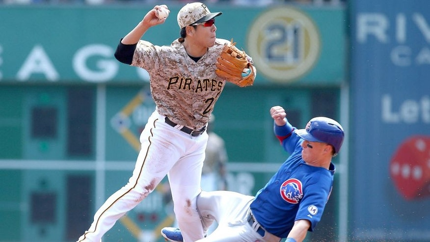 Sep 17, 2015; Pittsburgh, PA, USA; Chicago Cubs right fielder Chris Coghlan (8) slides into the left knee of Pittsburgh Pirates shortstop Jung Ho Kang (27) during the first inning at PNC Park. Dang left the game after suffering an apparent injury. Mandatory Credit: Charles LeClaire-USA TODAY Sports