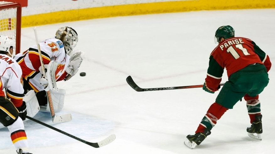 <p>Calgary Flames goalie Karri Ramo, left, of Finland, stops a shot by Minnesota Wild's Zach Parise, right, in the first period of an NHL hockey game, Friday, March 27, 2015, in St. Paul, Minn. (AP Photo/Jim Mone),Calgary Flames goalie Karri Ramo, left, of Finland, stops a shot by Minnesota Wild's Zach Parise, right, in the first period of an NHL hockey game, Friday, March 27, 2015, in St. Paul, Minn. (AP Photo/Jim Mone)</p>