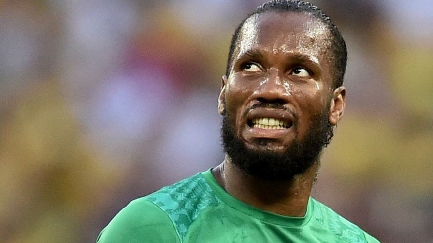 Ivory Coast's forward and captain Didier Drogba reacts during a Group C football match between Greece and Ivory Coast at the Castelao Stadium in Fortaleza during the 2014 FIFA World Cup on June 24, 2014. AFP PHOTO / ARIS MESSINIS