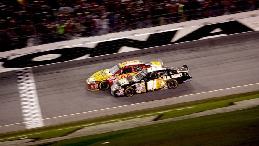 DAYTONA, FL - FEBRUARY 18: Kevin Harvick, driver of the #29 Shell/Pennzoil Chevrolet, leads Mark Martin, driver of the #01 U.S. ARMY Chevrolet, to the finish line to win the NASCAR Nextel Cup Series Daytona 500 at Daytona International Speedway on February 18, 2007 in Daytona, Florida. (Photo by Chris McGrath/Getty Images for NASCAR) *** Local Caption *** Kevin Harvick;Mark Martin