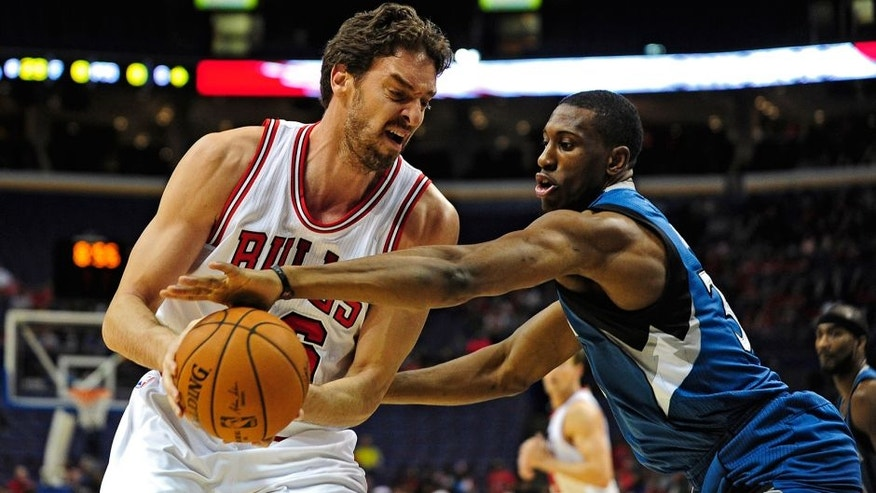 <p>Oct 24, 2014; St. Louis, MO, USA; Chicago Bulls forward Pau Gasol (16) dribbles the ball as Minnesota Timberwolves forward Thaddeus Young (33) defends during the first quarter at Scottrade Center. Mandatory Credit: Jeff Curry-USA TODAY Sports</p>