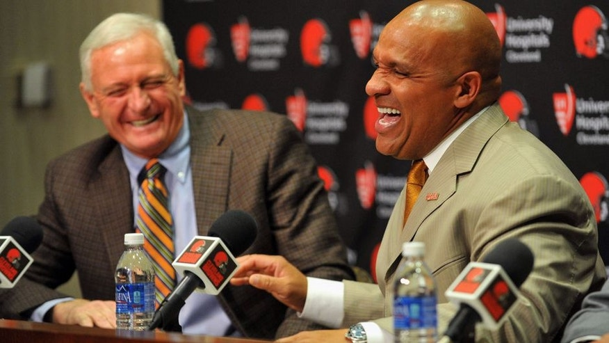 Jan 13, 2016; Berea, OH, USA; Cleveland Browns owner Jimmy Haslam (left) and new head coach Hue Jackson talk during a press conference at the Cleveland Browns training facility. Mandatory Credit: Ken Blaze-USA TODAY Sports