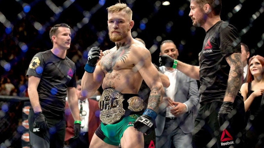 LAS VEGAS, NV - DECEMBER 12: UFC featherweight champion Conor McGregor celebrates his 13 second knockout victory over Jose Aldo in their featherweight championship fight during the UFC 194 event inside MGM Grand Garden Arena on December 12, 2015 in Las Vegas, Nevada. (Photo by Brandon Magnus/Zuffa LLC/Zuffa LLC via Getty Images)