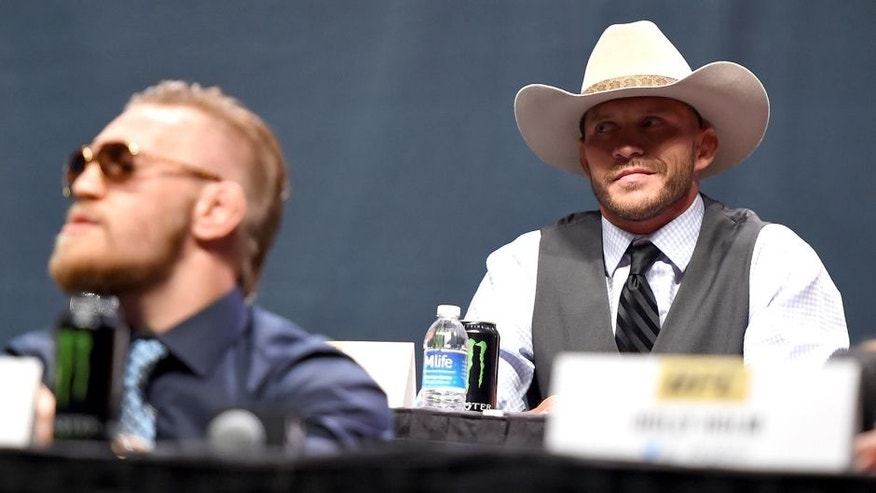 LAS VEGAS, NEVADA - SEPTEMBER 04: (R-L) UFC lightweight title challenger Donald 'Cowboy' Cerrone exchanges words with UFC interim featherweight champion Conor McGregor during the UFC's Go Big launch event inside MGM Grand Garden Arena on September 4, 2015 in Las Vegas, Nevada. (Photo by Jeff Bottari/Zuffa LLC/Zuffa LLC via Getty Images)