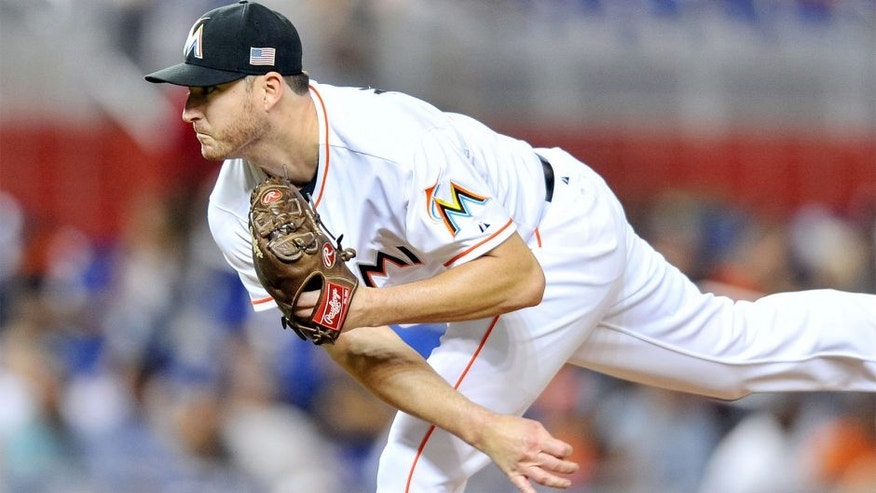 Sep 11, 2015; Miami, FL, USA; Miami Marlins relief pitcher Bryan Morris (57) delivers a pitch during the seventh inning against the Washington Nationals at Marlins Park. The Marlins won 2-1. Mandatory Credit: Steve Mitchell-USA TODAY Sports