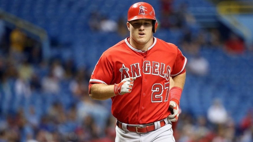 Jun 11, 2015; St. Petersburg, FL, USA; Los Angeles Angels center fielder Mike Trout (27) runs home after hitting a home run during the sixth inning against the Tampa Bay Rays at Tropicana Field. Mandatory Credit: Kim Klement-USA TODAY Sports