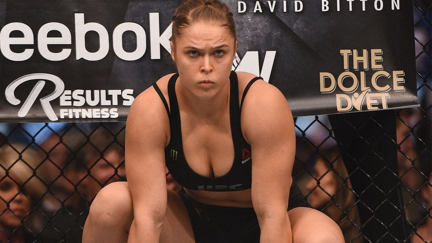 LOS ANGELES, CA - FEBRUARY 28: Ronda Rousey enters the Octagon in her UFC women's bantamweight championship bout against Cat Zingano during the UFC 184 event at Staples Center on February 28, 2015 in Los Angeles, California. (Photo by Jeff Bottari/Zuffa LLC/Zuffa LLC via Getty Images)