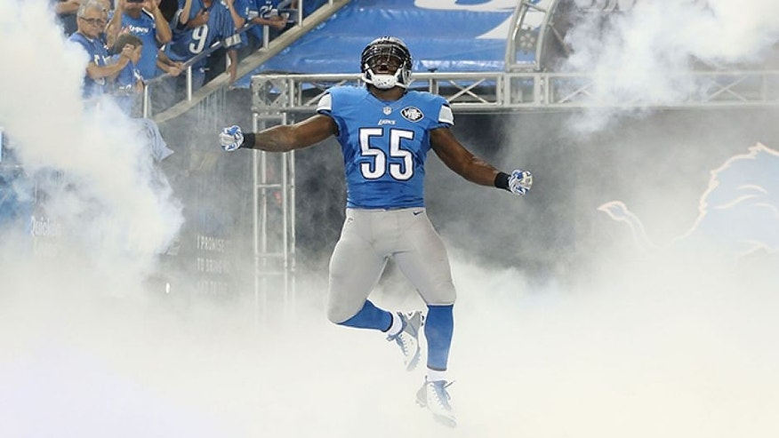DETROIT, MI - SEPTEMBER 21: Stephen Tulloch # 55 of the Detroit Lions runs onto the field during player introductions prior to the start of the game against the Green Bay Packers at Ford Field on September 21, 2014 in Detroit, Michigan. The Lions defeated the Packers 19-7. (Photo by Leon Halip/Getty Images) *** Local Caption *** Stephen Tulloch