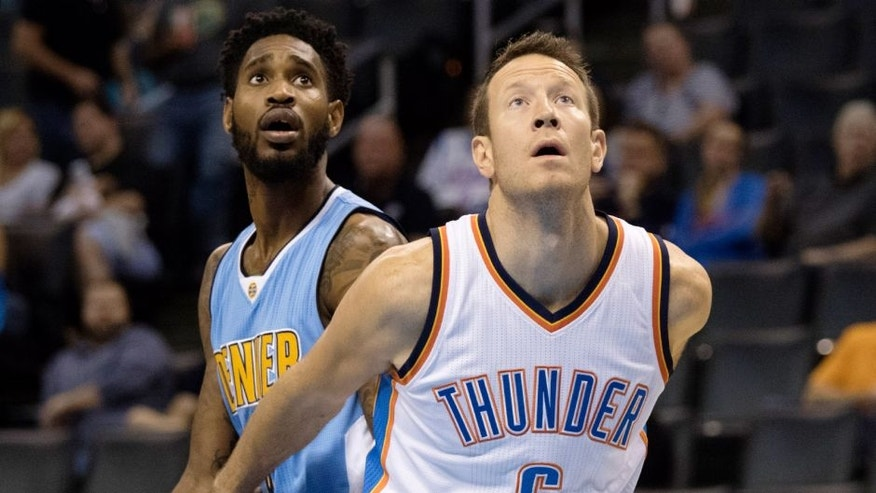 OKLAHOMA CITY, OK - OCTOBER 18: Will Barton #5 of the Denver Nuggets and Steve Novak #6 of the Oklahoma City Thunder during the fourth quarter of a NBA preseason game at the Chesapeake Energy Arena on October 18, 2015 in Oklahoma City, Oklahoma. NOTE TO USER: User expressly acknowledges and agrees that, by downloading and or using this photograph, User is consenting to the terms and conditions of the Getty Images License Agreement. (Photo by J Pat Carter/Getty Images)