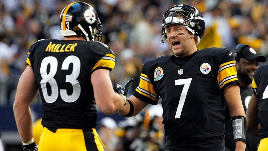 ARLINGTON, TX - DECEMBER 16: Ben Roethlisberger #7 of the Pittsburgh Steelers celebrates with Heath Miller #83 of the Pittsburgh Steelers after Miller scored against the Dallas Cowboys at Cowboys Stadium on December 16, 2012 in Arlington, Texas. (Photo by Tom Pennington/Getty Images)