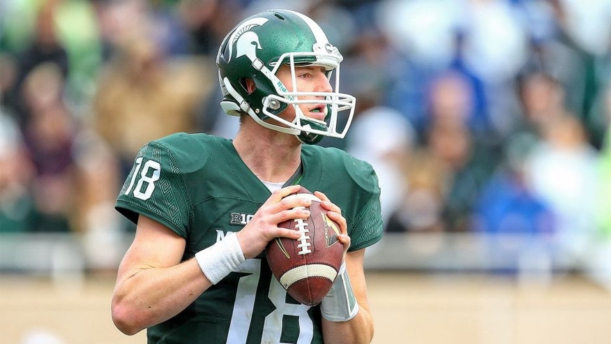 Oct 24, 2015; East Lansing, MI, USA; Michigan State Spartans quarterback Connor Cook (18) attempts to throw the ball against the Indiana Hoosiers during the 1st half of a game at Spartan Stadium. Mandatory Credit: Mike Carter-USA TODAY Sports