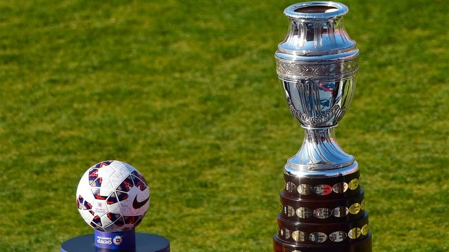 View of the Copa America trophy (R) and the football before the start of the 2015 Copa America football championship final Argentina vs Chile, in Santiago, Chile, on July 4, 2015. AFP PHOTO / MARTIN BERNETTI (Photo credit should read MARTIN BERNETTI/AFP/Getty Images)