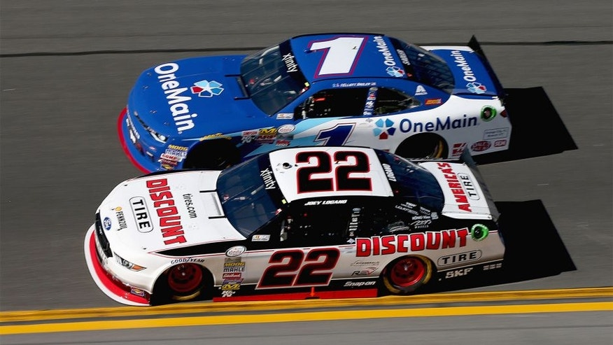 DAYTONA BEACH, FL - FEBRUARY 20: Joey Logano, driver of the #22 Discount Tire Ford, leads Elliott Sadler, driver of the #1 OneMain Chevrolet, during the NASCAR XFINITY Series PowerShares QQQ 300 at Daytona International Speedway on February 20, 2016 in Daytona Beach, Florida. (Photo by Sean Gardner/Getty Images)