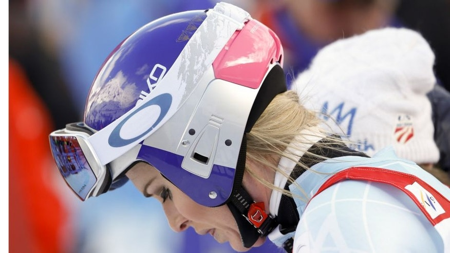 United States' Lindsey Vonn reacts after crashing during a women's Alpine ski downhill race, in La Thuile, Italy, Friday, Feb. 19, 2016. (AP Photo/Alessandro Trovati)