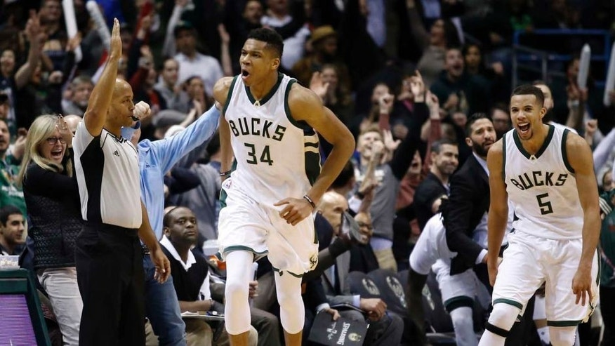 The Milwaukee Bucks' Giannis Antetokounmpo reacts after making a 3-pointer during overtime against the Atlanta Hawks on Friday, Jan. 15, 2016, in Milwaukee. The Bucks won 108-101.