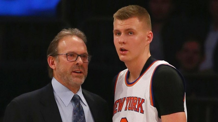 NEW YORK, NY - FEBRUARY 09: Interim Head Coach Kurt Rambis of the New York Knicks speaks to Kristaps Porzingis #6 during their game against the Washington Wizards at Madison Square Garden on February 9, 2016 in New York City. NOTE TO USER: User expressly acknowledges and agrees that, by downloading and/or using this Photograph, user is consenting to the terms and conditions of the Getty Images License Agreement. (Photo by Al Bello/Getty Images)
