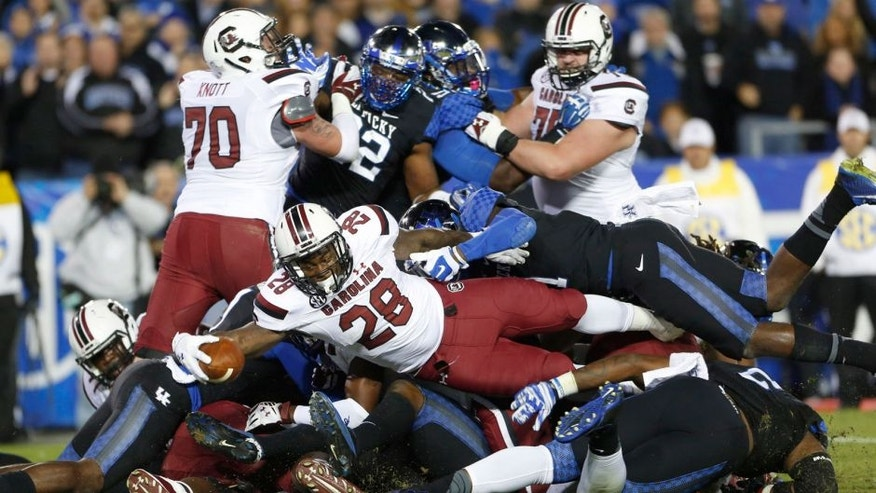 Oct 4, 2014; Lexington, KY, USA; South Carolina Gamecocks running back Mike Davis (28) scores a touchdown against the Kentucky Wildcats in the first half at Commonwealth Stadium. Mandatory Credit: Mark Zerof-USA TODAY Sports