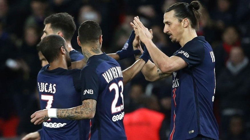 Paris Saint-Germain's Swedish forward Zlatan Ibrahimovic (R) celebrates with teammates after scoring a goal during the French L1 football match between Paris Saint-Germain (PSG) and Reims at the Parc des Princes stadium in Paris on February 20, 2016. AFP PHOTO / THOMAS SAMSON / AFP / THOMAS SAMSON (Photo credit should read THOMAS SAMSON/AFP/Getty Images)