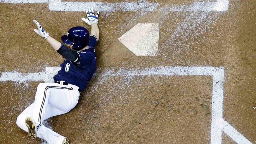 Tuesday, Sept. 1: The Milwaukee Brewers' Ryan Braun slides safely home during the first inning against the Pittsburgh Pirates in Milwaukee. Braun scored from first on a double by Adam Lind.