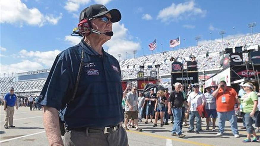 Team owner Joe Gibbs walks through the garage area during practice for Sunday's Daytona 500 NASCAR Sprint Cup Series auto race at Daytona International Speedway in Daytona Beach, Fla., Saturday, Feb. 20, 2016. (AP Photo/Phelan M. Ebenhack)